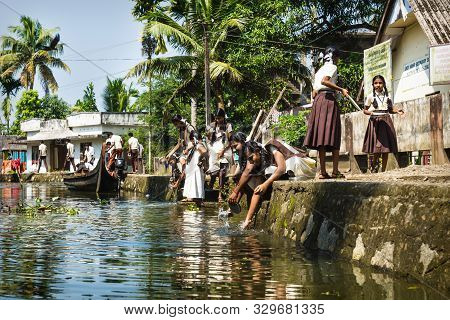 Alleppey - Alappuzha, India - 13 November 2017: Students Washing Out Their Bowls Along River In Kera