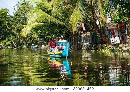 Alleppey - Alappuzha, India - 13 November 2017: Tourist Going With Local Man In The Small Canals Of