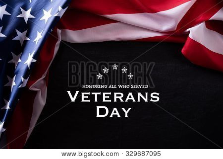 Happy Veterans Day. American Flags Veterans Against A Blackboard Background.
