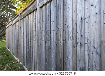 A Perspective View Of An Exterior Of A Wooden Fence