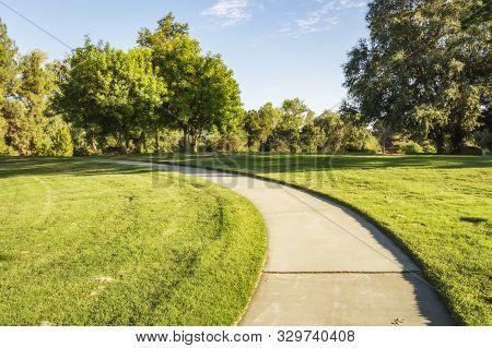 Walking A Path At The Davis Arboretum In Davis, California