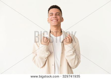 Excited Man With Closed Eyes Triumphing. Happy Handsome Young Man Triumphing And Shaking Fists Isola
