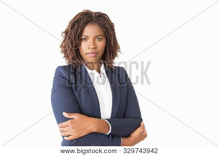 Serious Confident Female Business Leader Looking At Camera. Young African American Business Woman Wi