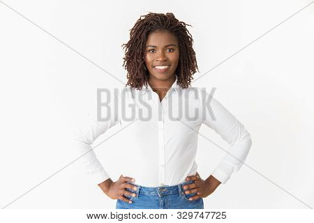 Happy Cheerful Sales Agent Keeping Hands On Hips. Young African American Business Woman Posing Isola
