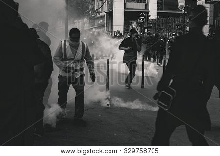 Paris, France. 1st December 2018. Riot Police uses a water canon and tear gas against demonstrators