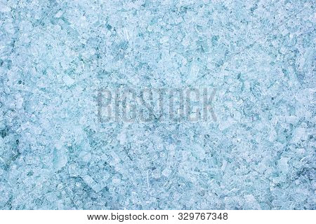 Fragments Of Blue Glass. Small And Sharp Fragments Of Broken Glass. Cullet For Creation Of New Glass