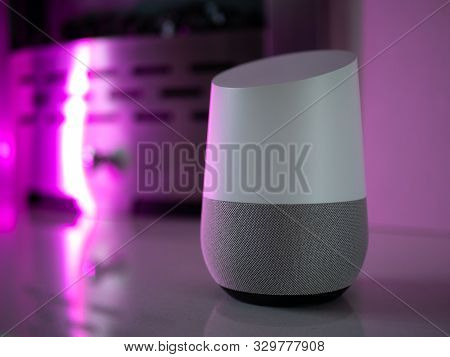 smart home speaker assistant on fireplace with led coloured ambient lighting - Pink poster