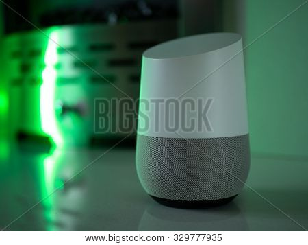 smart home speaker assistant on fireplace with led coloured ambient lighting - Green poster