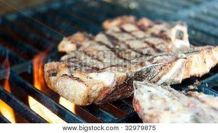 Steak On The Grill With Flames