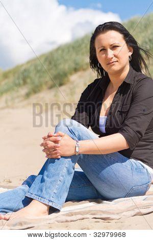 Beautiful brunette portrait on summer beach