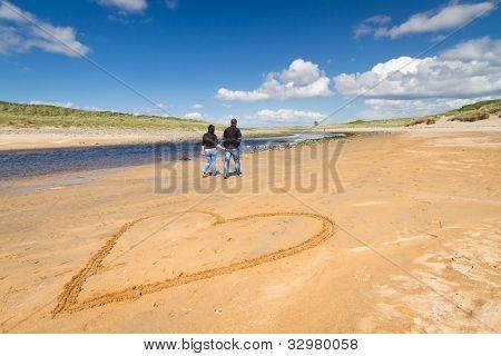Walk on the beach of loving couple