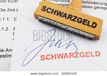 a stamp made of wood lying on a document. german inscription: black money