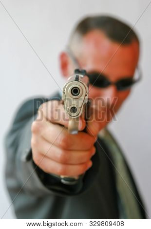 Caucasian man in a gun fight pointing the pistol to his adversary poster