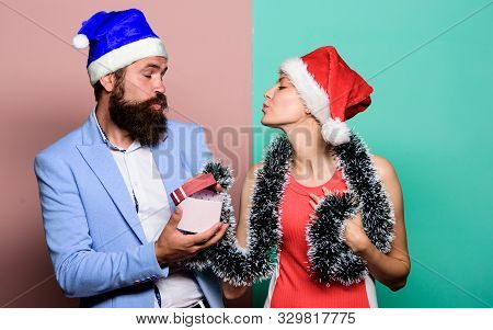 Christmas Party Office. Happy Man And Woman Wear Santa Hats. Cheerful Couple Celebrate New Year. Giv