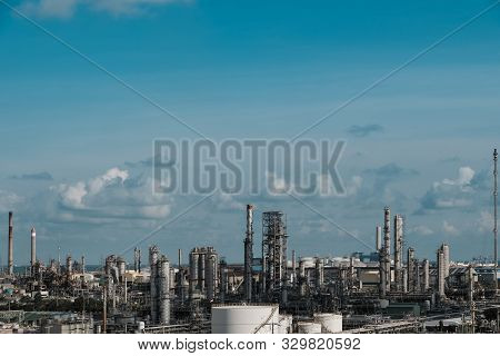 Gas Distillation Tower And Smoke Stack Of Petroleum Industrial Plant On Blue Sky Background, Downstr
