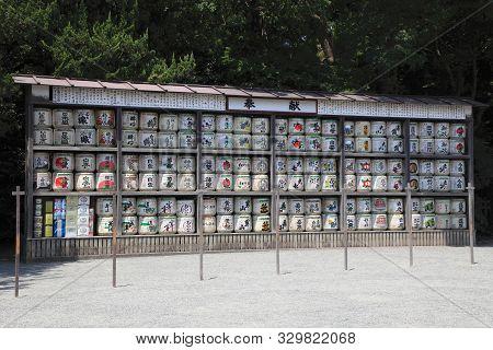 Kamakura, Japan - August 5, 2015: Stack Of Japanese Wine (sake) Barrels At A Shrine On August 5, 201