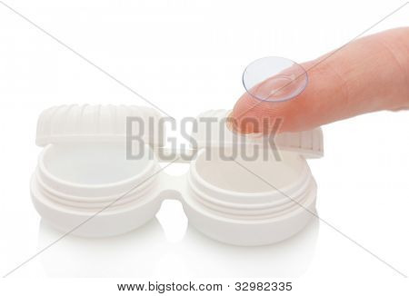 contact lens on finger and case isolated on white