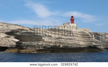 Small Ancient Red Lighthouse Called Madonetta Near Bonifacio Town In Corsica A French Island In The