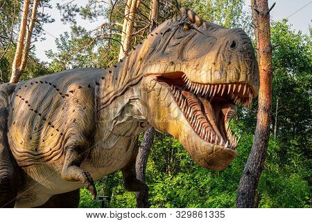 Belgorod, Russia - May 31, 2019: Full-size Tyrannosaurus Rex Statue In The Forest Of Belgorod Dinopa