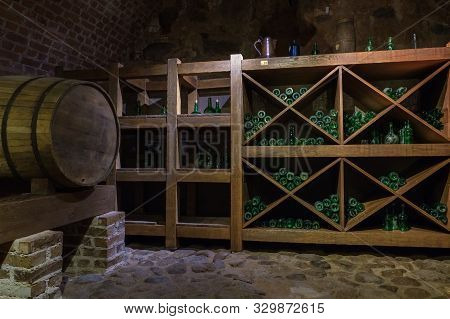 Mir, Belarus -  23-october-2019:  Wine Barrel And Bottles In Wine Cellar In Mir Castle. Mir, Grodno