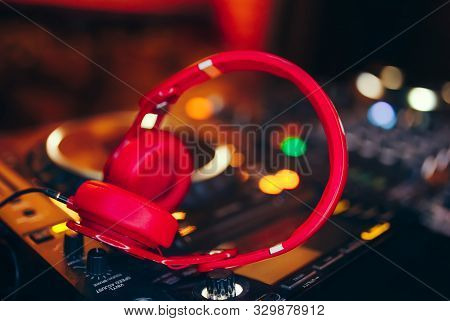 Closeup Pair Of Cheer Red Headphones For Dj.cd Mp4 Music Deejay Mixing Desk Music Party In Nightclub