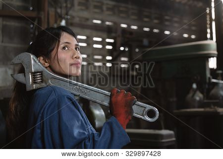 Multiracial Diverse Hispanic Asian Female Engineering Worker With Industrial Wrench Training In Manu