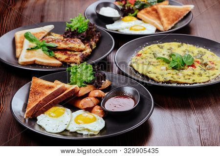 Breakfast Food Table. Festive Brunch Set, Meal Variety With Fried Egg, Pancakes, Croissants, Smoothi
