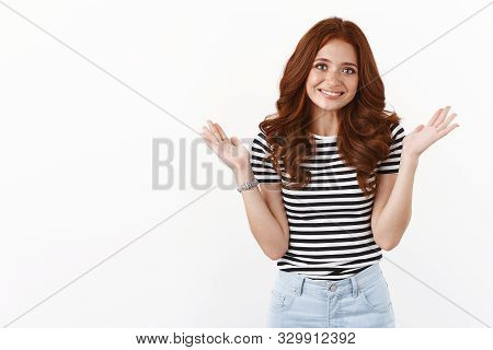 Sorry My Bad. Cute Silly Redhead Girl In Striped T-shirt Raising Hands Up In Surrender, Apologizing