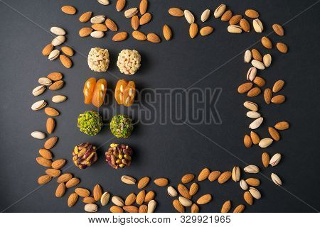 Healthy Snacks. Turkish No Sugar Food. Scattered Pistachio And Almond Nuts. Flat Lay. Middle East Pi