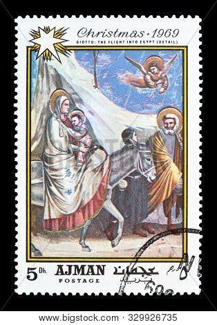 Cancelled Postage Stamp Printed By Ajman, That Shows Painting The Flight Into Egypt By Giotto, Circa
