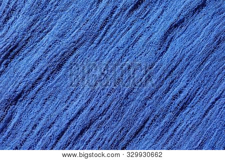 Blue Fabric Mesh. Close Up Rumpled Cloth Background.