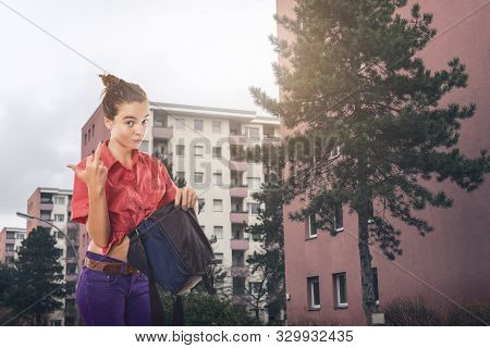 Angry Woman Showing The Finger While Searching In Her Bag