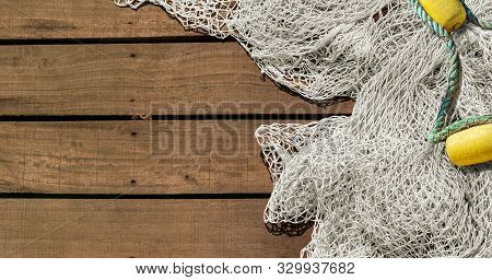 Fishing Net On Wooden Decking Background With Copy Space