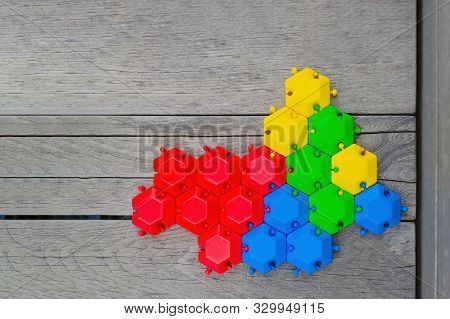 Connection Concept. Multi-colored Hexagons Connected Into One Whole. Green Blue Red Yellow