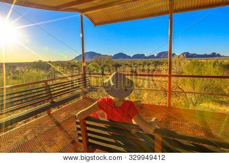 Uluru, Northern Territory, Australia - Aug 24, 2019: Tourist Woman Sitting On A Bench At Platform Du