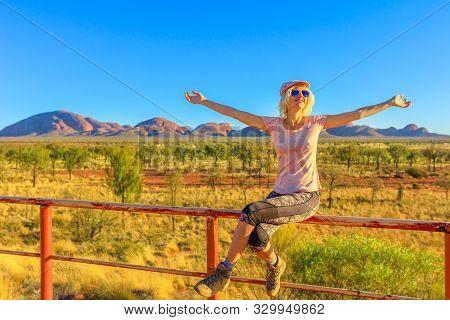 Uluru, Northern Territory, Australia - Aug 25, 2019: Tourist Woman Sitting On Balcony From Dune View