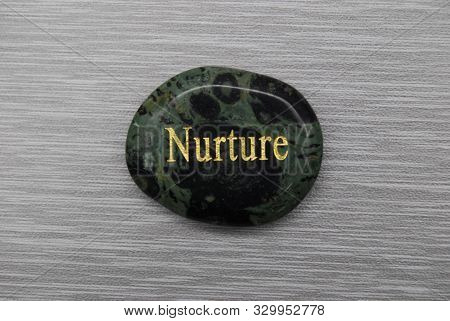 Nurture Mood Stone On A Gray Background