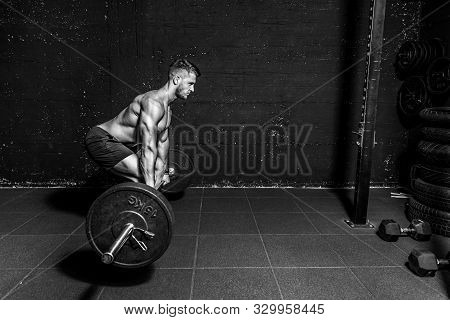 Barbell Deadlift Training, Young Strong Fit Muscular Sweaty Man With Big Muscles Doing Barbell Weigh