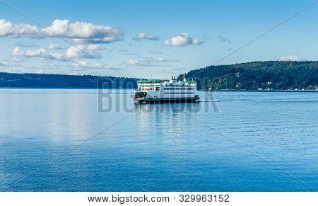 A Ferry Crossed The Puget Sound Near Tacoma, Washington.