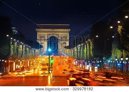 Arc De Triumph And Champs Elysees Boulevard Paris