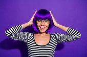 Photo of pretty lady listen unexpected lottery announcement wear specs wig striped pullover isolated purple background poster