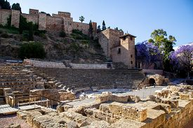 Malaga, Spain - May 25, 2019: Ruins Of The Old Roman Theatre In The Historic City Centre.