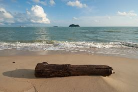 A Beached Timber With Islands Background At Samila Beach, Songkhla, Thailand.