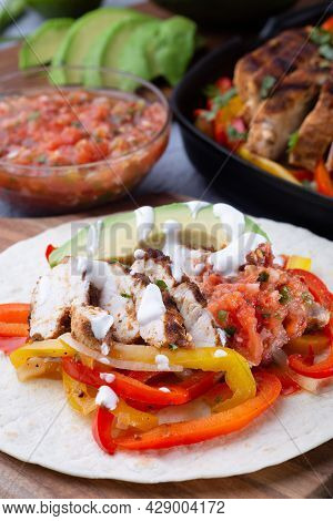Grilled Chicken Fajitas With Bell Pepper, Onion, Salsa Asada, Avocado And Sour Cream Served On Soft