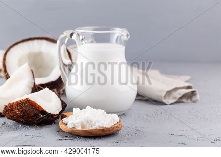 Vegan Powdered Milk Made From Coconut, Powder And Dissolved With Water In A Glass Jar, Lactose Free