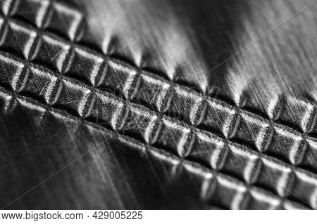 Abstract Black And White Background With Dissolving Squares. Selective Focus