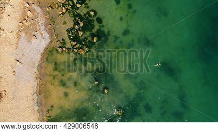 Dead Sea Coastline In Desert Uninhabited Extraterrestrial Landscape Aerial View. Girl Swims On The S