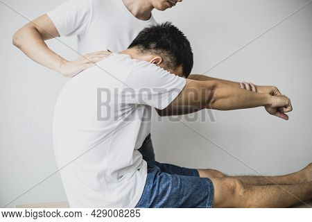 A Professional Physiotherapist Is Stretching The Back Muscles For Patients Who Undergo Therapy, Most