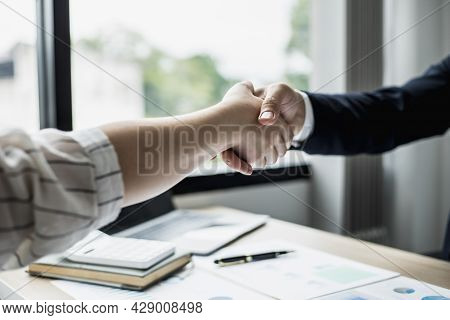 Two Businessmen Shake Hands, They Are Startup Friends Together, Business Partners Shake Hands After