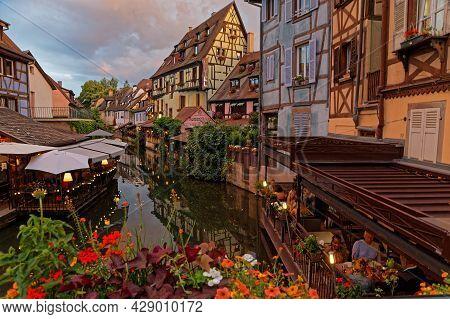 Colmar, France, June 25, 2021 : Petite Venise District At Night. Petite Venise Is A Picturesque Tour